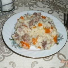 Рисовая каша с куриными желудками