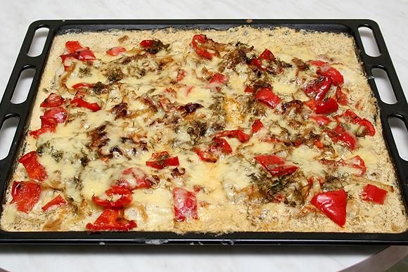 Достать посыпать тертым сыром и запекать еще 15 мин.
